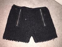 Girls black mini sparkly shorts.