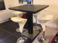 Modern high standing table and 4 bar stools