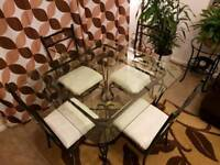 Glass topped, square, dining table with matching 4 chairs