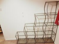 Glass and metal shelf unit (stairs)