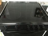 Black electric cooker with hob