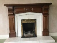 Fireplace with Mahogany surround and marble insert and hearth for sale. £50.00 ono.