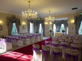 70 Ivory Chair Covers with Purple Ribbons