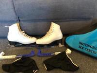 White size 36 figure ice skates