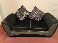 Two Seater Sofa with cushions included