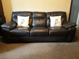 For sale. Brown leather 3 + 2 suite. £250.