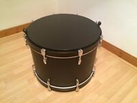 """Upcycled wooden 22"""" bass drum coffee storage table with castors"""