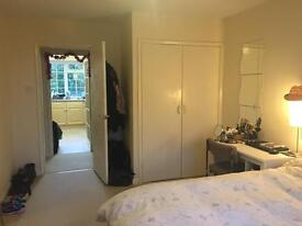 A double bedroom with small double bed to share