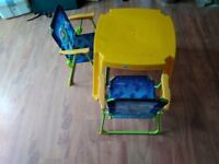 child's outside table and 2 folding chairs