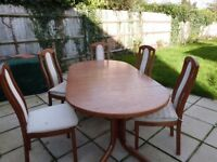 Real Oak extendable dining table with 8 chairs