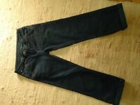 Ladies stylish cut off jeans with stitched turn ups. Size 8.