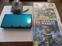 nintendo 3ds console with 3d mario world and lego star wars
