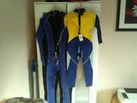 Two brand new with tags crane long sleeved wet suits one adult one child