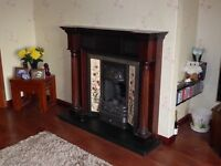 Solid Hardwood Surround and Cast Iron Fireplace with Slate Hearth & Magiglo Living Flame gas fire