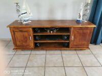 Soldid hardwood TV unit, takes up to 60 inch TV easily.