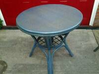Round table and two chairs ideal for a conservatory