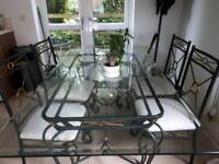 Dining room table glass top. 6 chairs