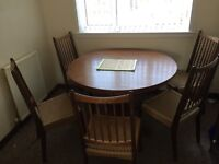 Extending dining table and chairs gc