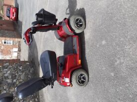 Red mobility scooter for sale...small broken area at the front