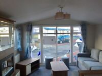 BRAND NEW STATIC CARAVAN ON PEACEFUL PARK. NO AMENITIES ON PARK BUT LOVELY VILLAGE RIGHT OUTSIDE,