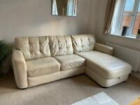 Cream leather sofa right hand chaise with integrated bed
