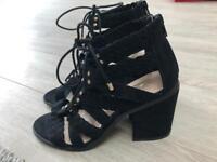 Size 4 black swede tie up shoes
