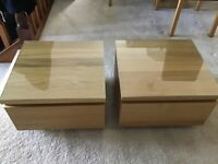 2 x Oak single drawer bedside cabinets with protective glass.
