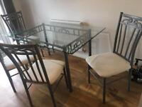 Glass top/metal frame dining table with 6 chairs