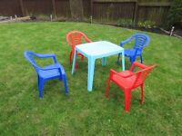 Plastic table & 4 chairs for pre-school age children