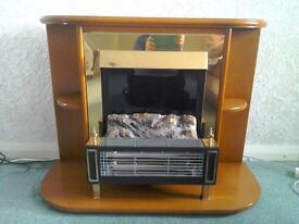 Lovely electric fire with polished wood surround