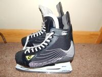 Adult Size 12 (European 46) Graf Ice hockey skates. Excellent condition.