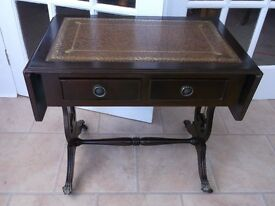 LEATHER TOPPED , DROP LEAF TABLE WITH CLAW CASTOR FEET AND 2 DRAWERS
