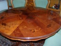 Beautiful round table 4 ft diameter perfect condition plus six green chairs we have used with it.