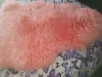 Brand new sheepskin pink rug size 94 cm length 3ft