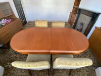 Extendable wooden table; four chairs included