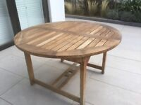 Collection of teak garden furniture, dining table, chairs, storage box, cushions, side tables