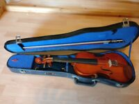 Stentor violin with spare strings