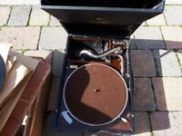 very old wind up record player and records