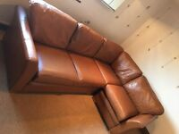 Brown leather corner sofabed