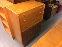 1950/60 chest of three drawers with cupboard with shelves underneath