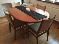 Nathan solid teak extendable dining table with four D-Scan chairs