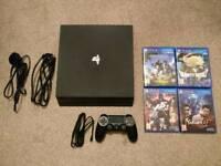 PS4 Pro 1TB + 4 Games