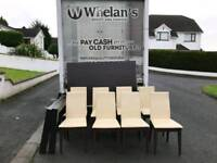 heavy dark wood dining room table and 8 cream leather chairs