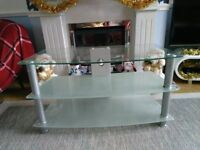 LARGE GLASS AND SILVER TV STAND.