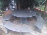 Garden solid slate table with four slate benches, will seat 8-10 people comfortably.