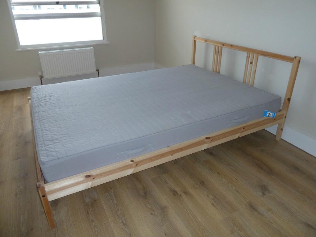 ikea wooden double bed in esher surrey gumtree. Black Bedroom Furniture Sets. Home Design Ideas