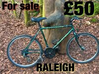 Raleigh Outland gents mountain bike 18 gears 20 inch frame 26 inch wheels