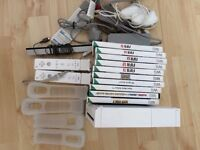 Wii console plus 2 controllers, 10 games inc FIFA 11-15