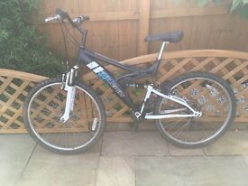 Raleigh Adult Mountain bike. Shimano gears. Double suspension. Includes spare tyre.