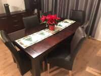 Solid wood dining table and set of 6 leather chairs.